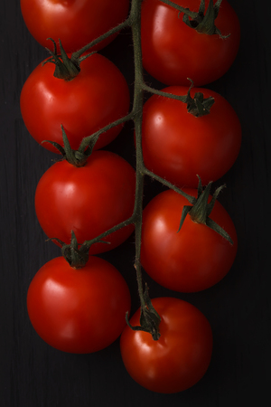 organic fresh cherry tomatoes on black board background still life vegetable raw fresh food healthy