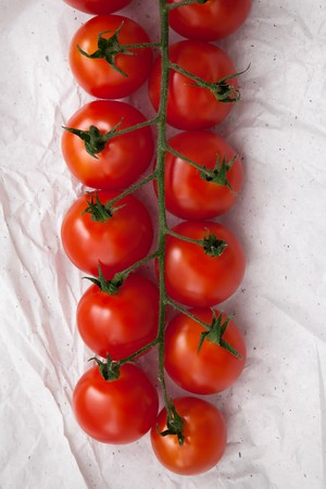 organic fresh cherry tomatoes on white paper background still life vegetable raw fresh food healthy