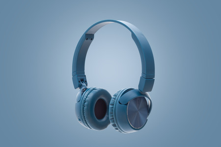 wireless blue headphone on blue background studio pack shot equipment
