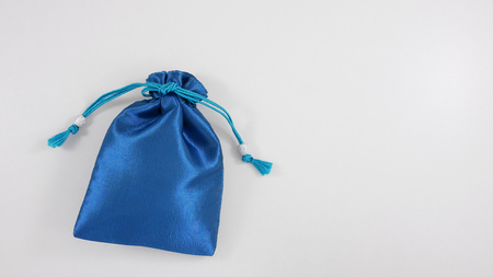 The blue silk mini gift pouch bag to hold jewelry. 1