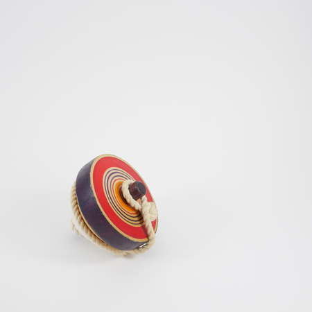 string top: The old wooden spinning top toy with string. 1 Stock Photo