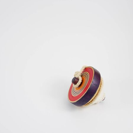 string top: The old wooden spinning top toy with string. 2 Stock Photo