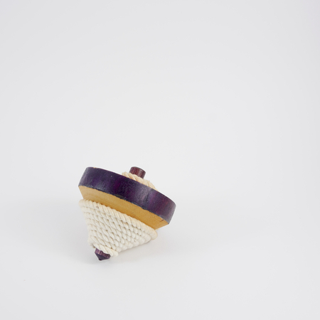 revolve: The old wooden spinning top toy with string. 3