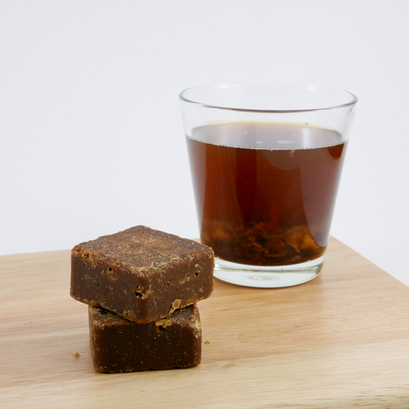 The Taiwan brown sugar ginger tea cubes on the wooden board. 스톡 콘텐츠