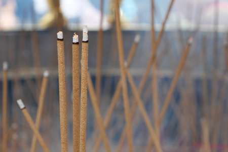 temple burn: The joss sticks burning in big joss stick pot at the Chinese temple. Stock Photo
