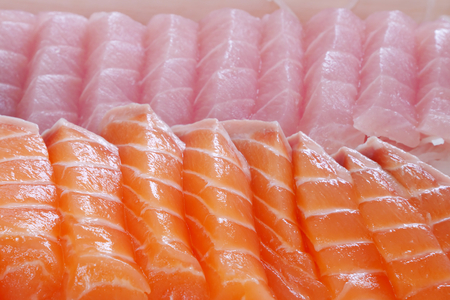 almuerzo: The close up of Japanese fresh sashimi salmon and fatty tuna in white lunch box set.