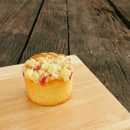 blueberry muffin: The delicious blueberry muffin and wooden board on the old deep brown planks.