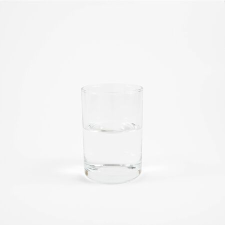 glass half full: The half full glass of pure mineral water