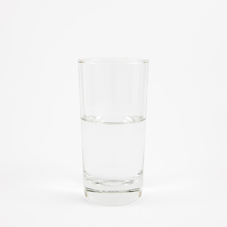 half full: The half full glass of pure mineral water. Stock Photo