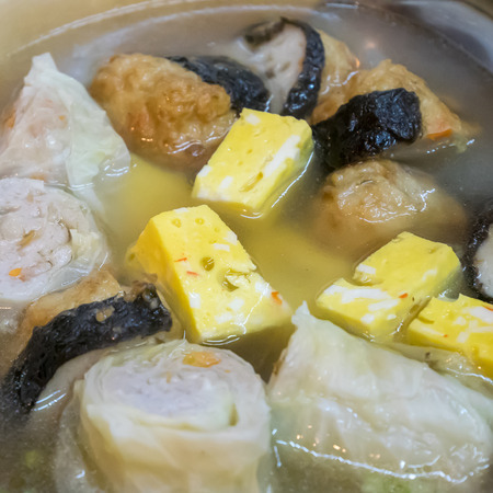 taiwanese: The close up of Taiwanese oden meat balls in soup at food street night market in Taipei, Taiwan. Stock Photo