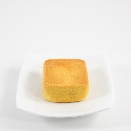 taiwanese: The tasty Taiwanese pineapple pastry cake on the small white square dish.