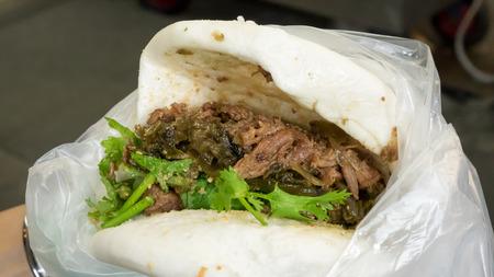 gua: The close up of Taiwanese Pork Steamed Sandwich bun (gua bao) at food street market in Taipei, Taiwan.