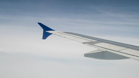 The airplane wing on the beautiful cloudy and sky. Reklamní fotografie