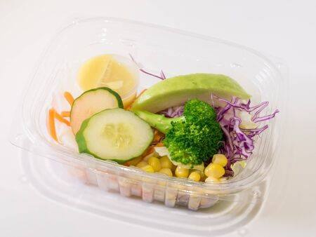 The close up of fresh salad set in the clear plastic box. Reklamní fotografie