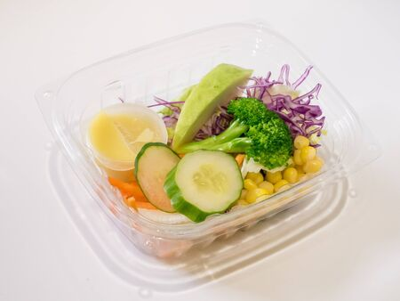 The close up of fresh salad set in the clear plastic box. Stock Photo
