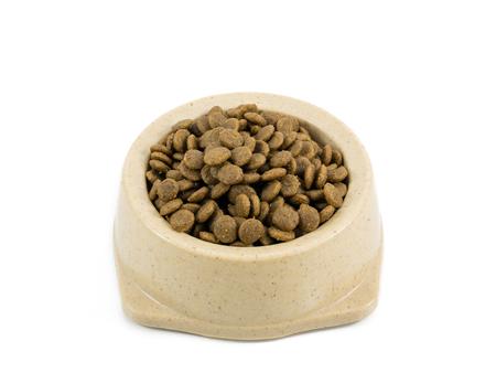 The close up of kibbles (dog food) in brown plastic dog bowl. Reklamní fotografie