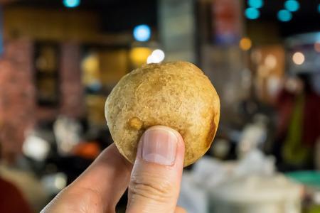 The close up of Taiwan deep fried taro ball at food street night market in Taipei.