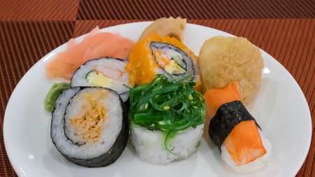 The group of delicious Sushi (Japanese food) on white plate.