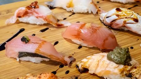 The close up of Japanese sushi set on wooden board in Japan restaurant. Reklamní fotografie