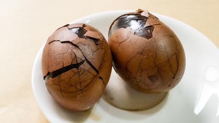 The close up of Taiwan Tea Eggs on mini white plate.