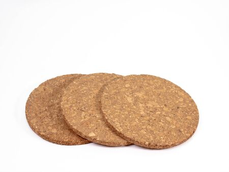 The close up of wooden cork coasters on white background. Stockfoto