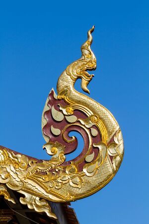 gable: Traditional Naga shaped on eave, gable, or roof. Northern Thailand Stock Photo