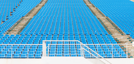 empty blue plastic grandstand seats or stadium seats, pattern with number Stock Photo