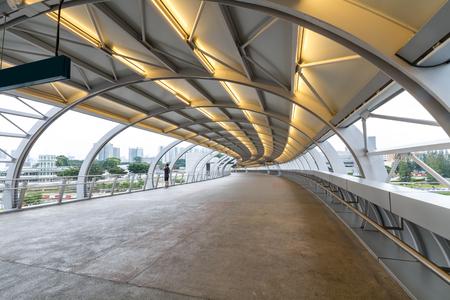 overpass: Perspective curved overpass walkway, footbridge