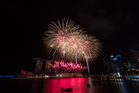 Fireworks over Marina Bay during Singapore national day parade combined Rehearsal in Marina bay, Singapore