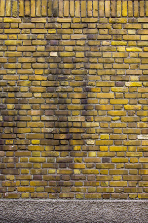 sorted: Sorted old yellow brick wall textures and background Stock Photo