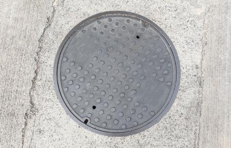 manhole: Rusty, grunge manhole cover in original background Stock Photo