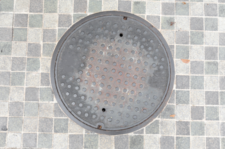 manhole cover: Rusty, grunge manhole cover in original background Stock Photo