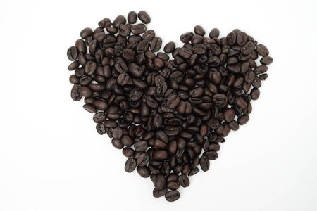 Old coffee bean in heart shape with white background