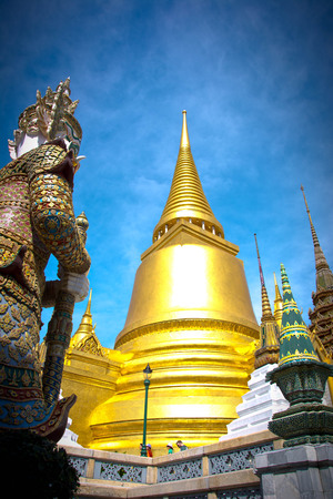 knew: Golden pagoda of Wat Phra Kaew thailand with green giant.