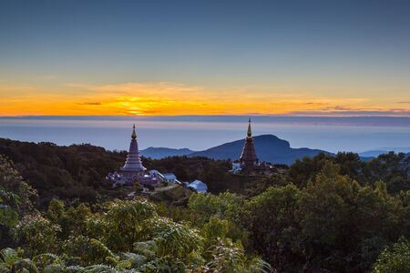 rise to the top: Sun rise at Pagoda on the top of mountain, Inthanon national park, Chiang Mai,Thailand