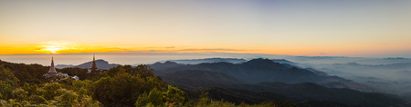 rise to the top: Panorama of Sun rise at Pagoda on the top of mountain, Inthanon national park,Chiang Mai, Thailand