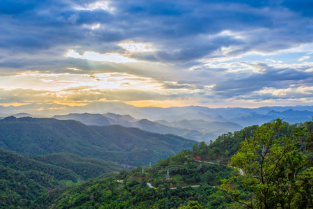 transcendence: Sun rays bursting through the clouds with mountain view , Mae Hong Son ,Thailand
