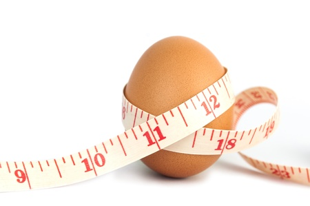 Measurement tape wrapped around the egg, nutrition concept photo