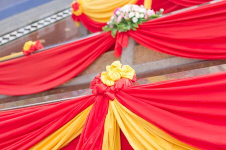 tied together: Red, yellow ribbons tied together