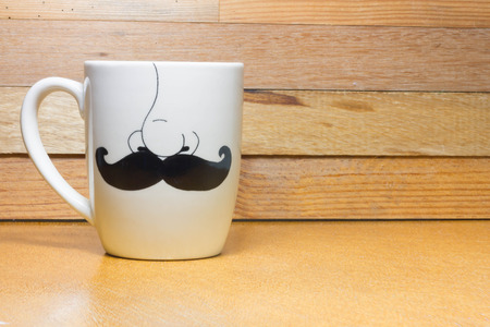 Coffee mug ,concept whiskers on the wooden background Stock Photo