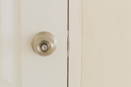 door lock: Door lock on the white door is open Stock Photo