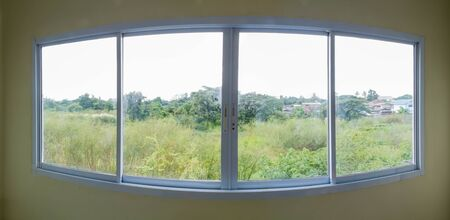 aluminum: Panorama of overlooking view from building glass windows on white aluminum frames