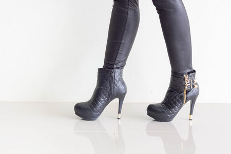 leather pants: Woman wearing black leather pants and high heel shoes