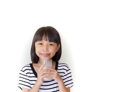 encouraged: Gorgeous little girl wearing striped encouraged to drink milk