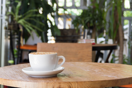 tazas de cafe: A cup of Coffee, latte on the wooden table