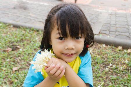 girl holding flower: Cute Toddler Girl holding flower