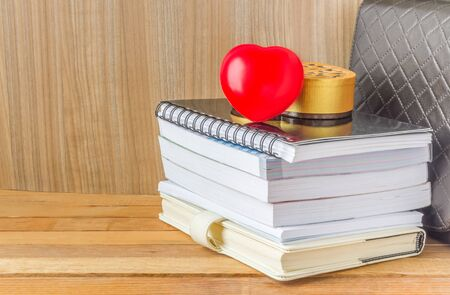 magazine stack: A lot of books with red heart on a wooden table Stock Photo