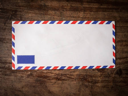 air mail: Air mail letter on wood background.