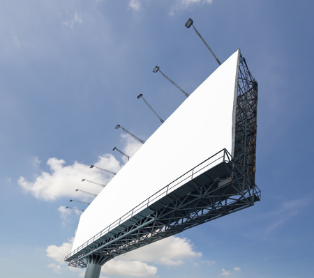 advertising signs: Blank billboard at a day on blue sky with cloud for advertisement