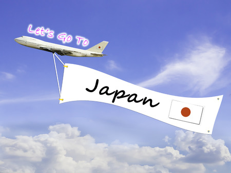 let go: Word Let go to  and Japan on Blue sky and cloud with airplane background Stock Photo